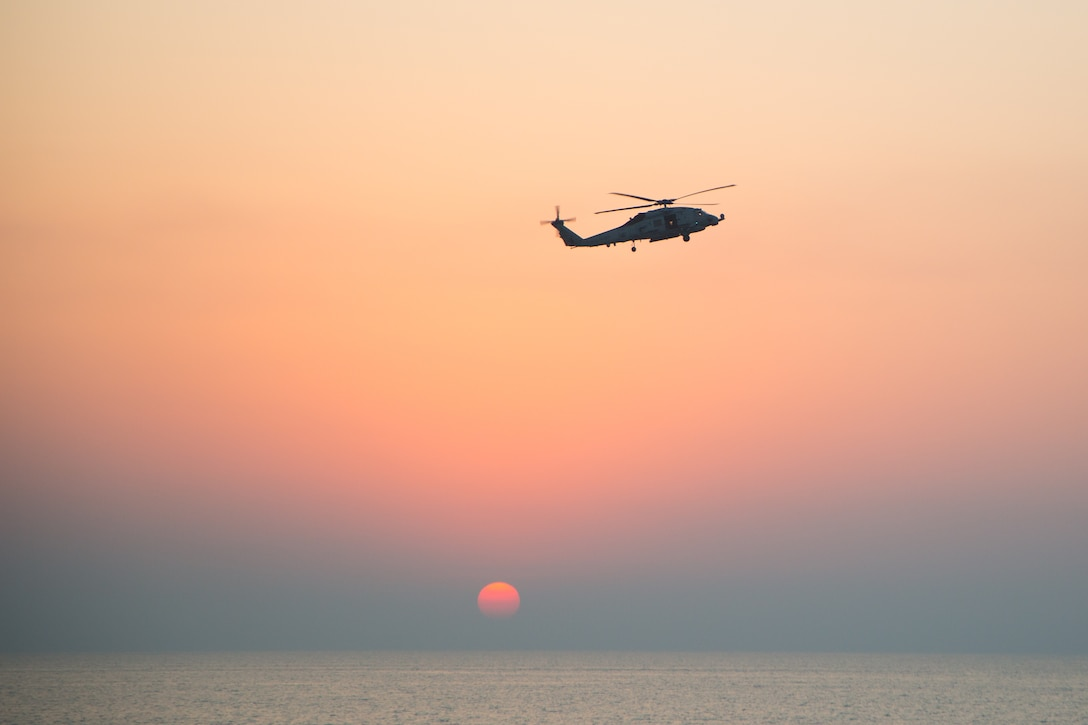 An MH-60R Seahawk helicopter participates in the joint air operations in support of maritime surface warfare (AOMSW) exercise in the Arabian Gulf, Sept. 24. Combined integration operations between joint U.S. forces are regularly held to maintain interoperability and the capability to counter threats posed in the maritime domain, ensuring freedom of navigation and free flow of commerce throughout the region's heavily trafficked waterways. (U.S. Army photo by Spc. Joshua DuRant)