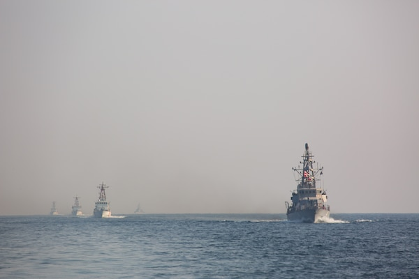 Navy coastal patrol ships and Coast Guard patrol boats, attached to Task Force (TF) 55, sail in formation during the joint air operations in support of maritime surface warfare (AOMSW) exercise in the Arabian Gulf, Sept. 24. Combined integration operations between joint U.S. forces are regularly held to maintain interoperability and the capability to counter threats posed in the maritime domain, ensuring freedom of navigation and free flow of commerce throughout the region's heavily trafficked waterways. (U.S. Army photo by Spc. Joshua DuRant)