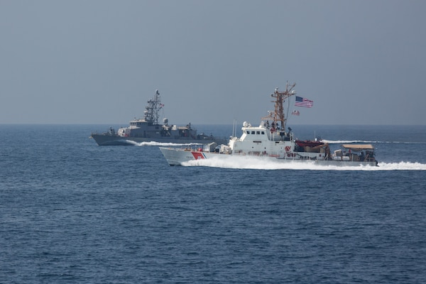 The Coast Guard patrol boat USCGC Wrangell (WPB 1332), front, and the Navy coastal patrol ship USS Monsoon (PC 4), both attached to Task Force (TF) 55, participate in the joint air operations in support of maritime surface warfare (AOMSW) exercise in the Arabian Gulf, Sept. 23. Combined integration operations between joint U.S. forces are regularly held to maintain interoperability and the capability to counter threats posed in the maritime domain, ensuring freedom of navigation and free flow of commerce throughout the region's heavily trafficked waterways. (U.S. Army photo by Spc. Joshua DuRant)