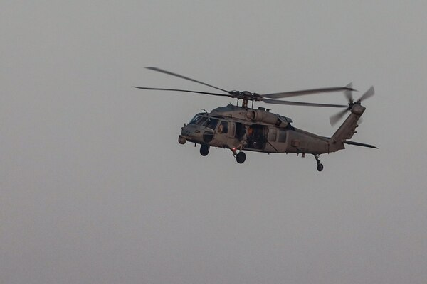 An MH-60R Seahawk helicopter conducts support of the joint air operations in support of maritime surface warfare (AOMSW) exercise in the Arabian Gulf, Sept. 24. Combined integration operations between joint U.S. forces are regularly held to maintain interoperability and the capability to counter threats posed in the maritime domain, ensuring freedom of navigation and free flow of commerce throughout the region's heavily trafficked waterways. (U.S Army photo by Spc. William Gore)