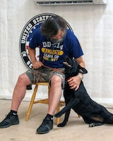A veteran meets his new service dog. Chairs are set-up for veterans on graduation day at the United States Veterans Service Dogs satellite training facility in Bergheim, Texas, where service dogs are paired with their new owners.
