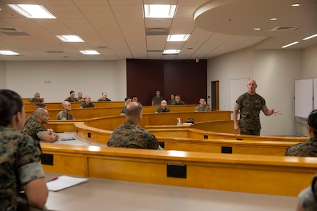 The 19th Sergeant Major of the Marine Corps, Sgt. Maj. Troy E. Black speaks to instructors at the Staff Non Commissioned Officer Academy at Marine Corps Base Camp Johnson, Jacksonville, N.C., Sept. 17, 2020. The visit allowed Sgt. Maj. Black to address Marines about leadership and the responsibilities and abilities of the SNCO rank. The College of Enlisted Military Education provides a continuum of education to improve leadership, sharpen critical and creative thinking skills, and deepen Marines' understanding of warfighting concepts in distributed and joint environments in order to foster ethical, professional leaders who make sound decisions in complex operational situations. (U.S. Marine Corps photo by Sgt. Victoria Ross)