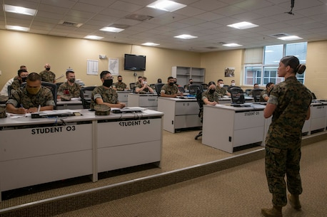 The 19th Sergeant Major of the Marine Corps, Sgt. Maj. Troy E. Black observes an entry level class at the Marine Corps Combat Service Support School (MCCSSS) at Marine Corps Base Camp Johnson, Jacksonville, N.C., Sept. 17, 2020. During the visit Sgt. Maj. Black discussed the importance of sustaining the transformation as Marines prepare to graduate from their entry level school. MCCSSS develops, conducts and evaluates formal training for entry, intermediate and advanced level officer, enlisted and civilian students in Personnel Administration, Ground Supply Support and Distribution, Financial Management and Logistics Operations, as well as Marine Corps Water Survival training. (U.S. Marine Corps photo by Sgt. Victoria Ross)