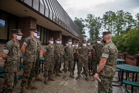 The 19th Sergeant Major of the Marine Corps, Sgt. Maj. Troy E. Black speaks to Marines attending the Landing Support Specialist Course at Marine Corps Combat Service Support School (MCCSSS) at Marine Corps Base Camp Johnson, Jacksonville, N.C., Sept. 17, 2020. During the visit Sgt. Maj. Black discussed the importance of sustaining the transformation as Marines prepare to graduate from their entry level school. MCCSSS develops, conducts and evaluates formal training for entry, intermediate and advanced level officer, enlisted and civilian students in Personnel Administration, Ground Supply Support and Distribution, Financial Management and Logistics Operations, as well as Marine Corps Water Survival training. (U.S. Marine Corps photo by Sgt. Victoria Ross)