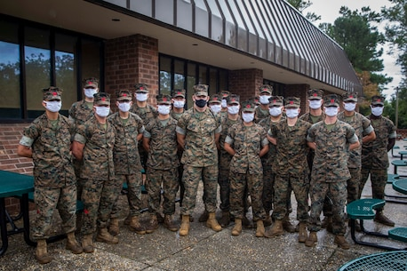 The 19th Sergeant Major of the Marine Corps, Sgt. Maj. Troy E. Black stands for a photo with Marines attending the Landing Support Specialist Course at Marine Corps Combat Service Support School (MCCSSS) at Marine Corps Base Camp Johnson, Jacksonville, N.C., Sept. 17, 2020. During the visit Sgt. Maj. Black discussed the importance of sustaining the transformation as Marines prepare to graduate from their entry level school. MCCSSS develops, conducts and evaluates formal training for entry, intermediate and advanced level officer, enlisted and civilian students in Personnel Administration, Ground Supply Support and Distribution, Financial Management and Logistics Operations, as well as Marine Corps Water Survival training. (U.S. Marine Corps photo by Sgt. Victoria Ross)