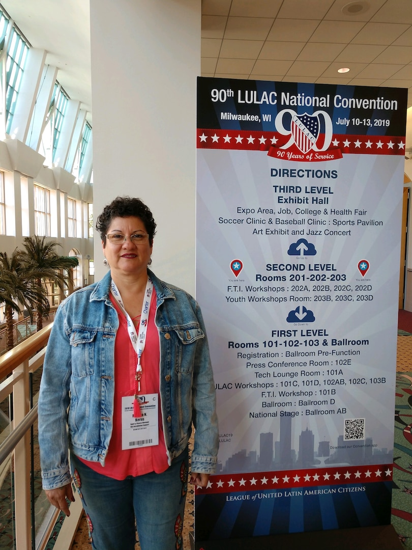 Martha Kerns near a poster at a conference