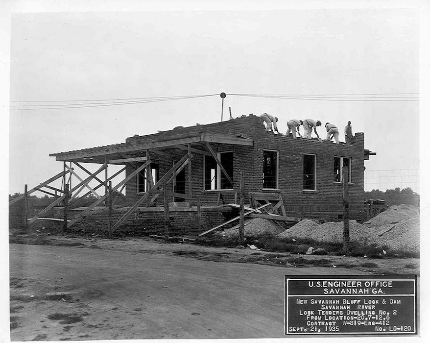 Workers built support buildings, such as these houses for the lock keepers, in addition to the lock and dam, 1935.