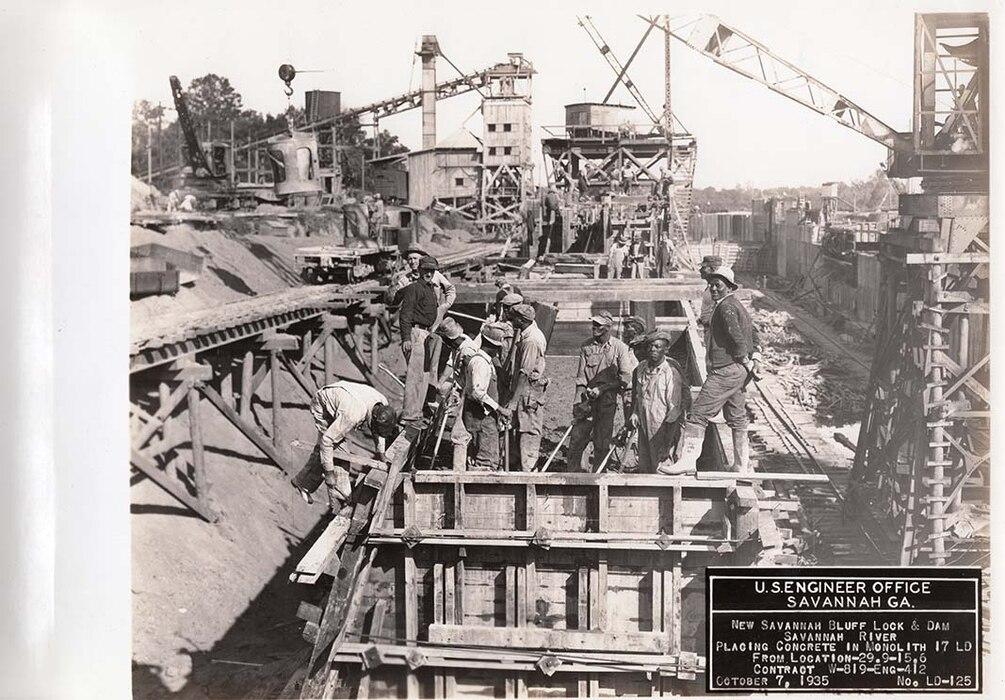 Men place concrete inside the coffer dam, 1935.