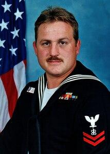 Portrait of Electronic Warfare Technician 2nd Class Kevin S. Rux.