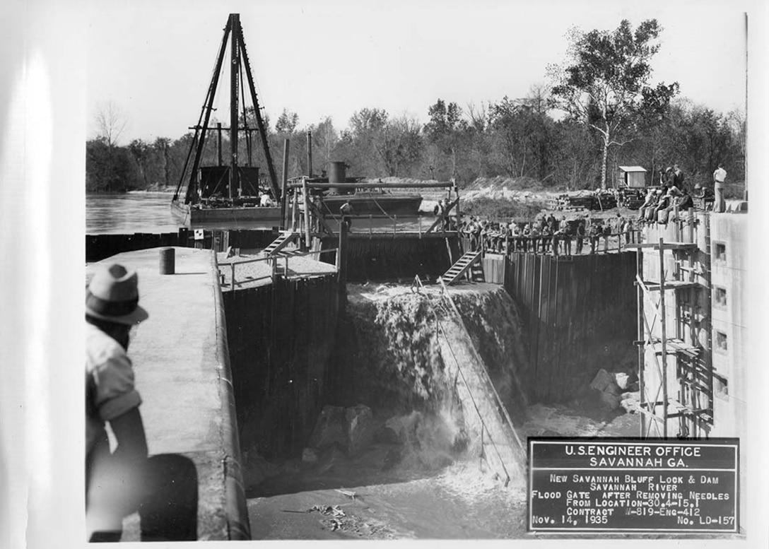 Workers flood the coffer dam, 1935.