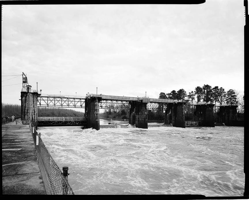 Overall view of dam from downstream outer lock wall, facing east, 2020.