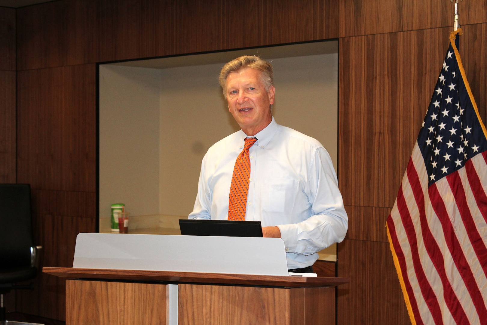A man speaks at a podium.