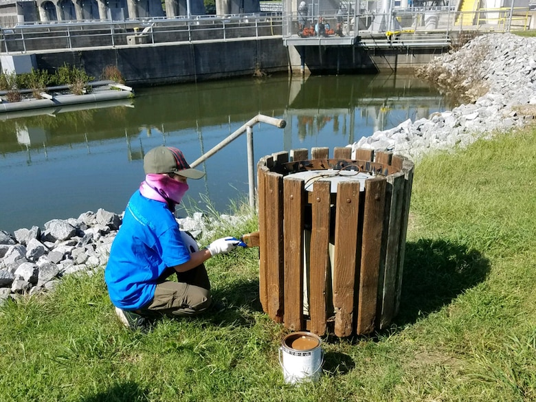 A Cub Scout from Pack 503 paints a trash receptacle at Cheatham Lake in Ashland City, Tennessee, Sept. 19, 2020 in support of National Public Lands Day. (USACE photo by Amber Jones)