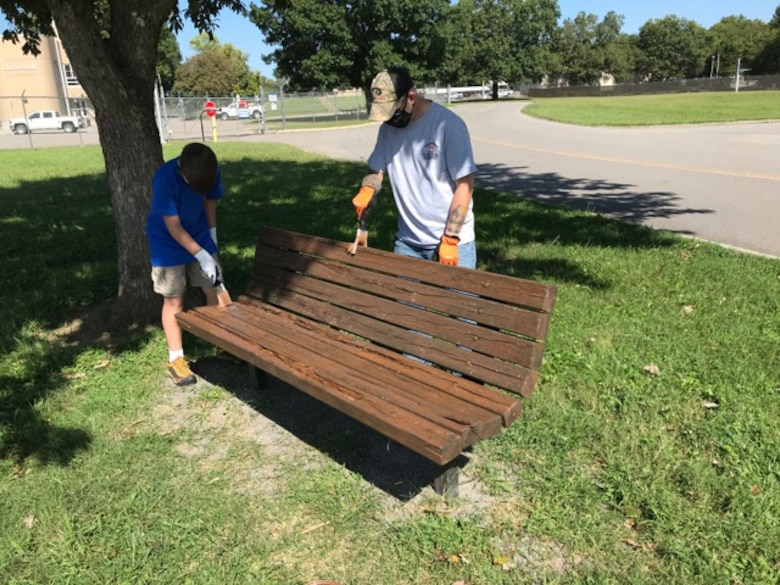A Cub Scout and leader from Pack 503 paint a park bench at Cheatham Lake in Ashland City, Tennessee, where they volunteered Sept. 19, 2020 in support of National Public Lands Day. (USACE photo by Samantha Bedard)