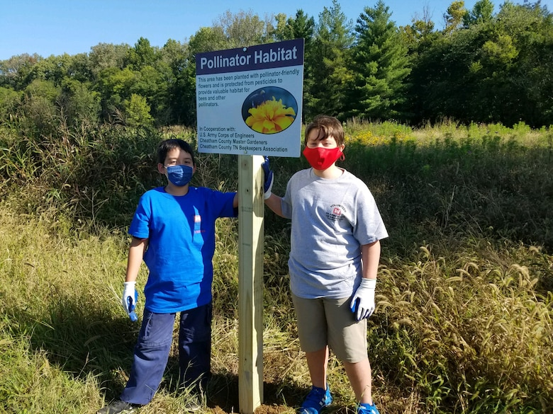 Cub Scouts from Pack 503 dig a hole for a new pollinator habitat sign at Cheatham Lake in Ashland City, Tennessee, Sept. 19, 2020 in support of National Public Lands Day. (USACE photo by Amber Jones)