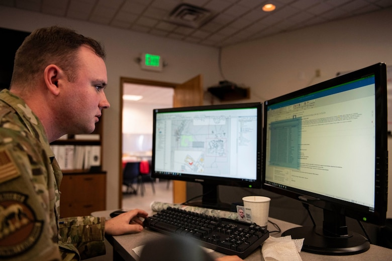 Tech. Sgt. Kevin Cuningham,  9th Civil Engineer Squadron noncommissioned officer in charge of execution support, works with a map and data on Beale Air Force Base.
