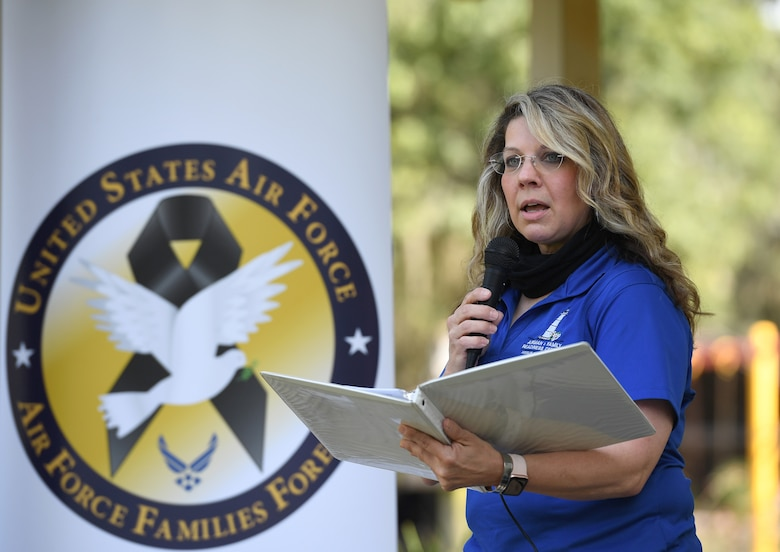 Holly Fisher, 81st Force Support Squadron Air Force Families Forever coordinator, delivers remarks during the Butterfly Release Ceremony honoring Keesler's Fallen Heroes at the Marina at Keesler Air Force Base, Mississippi, Sept. 25, 2020. The event was held in conclusion of Gold Star Family Remembrance Week, which honored the families of fallen service members. (U.S. Air Force photo by Kemberly Groue)