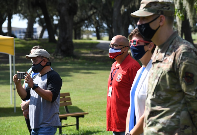 Keesler personnel attend the Butterfly Release Ceremony honoring Keesler's Fallen Heroes at the Marina at Keesler Air Force Base, Mississippi, Sept. 25, 2020. The event was held in conclusion of Gold Star Family Remembrance Week, which honored the families of fallen service members. (U.S. Air Force photo by Kemberly Groue)