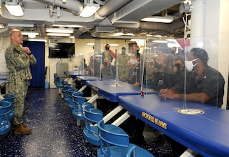 Master Chief Petty Officer of the Navy (MCPON) Russell Smith speaks with Sailors during an all hands call aboard the the future USS Delbert D. Black (DDG 119). The Navy will commission Delbert D. Black, the first ship in naval history to be named after the first MCPON.
