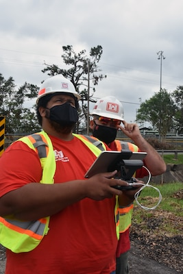 Charles McKenzie, left, and Michael Baker operate a drone in Sulpher, La., on Sept. 20, 2020, in support of Operation Blue Roof in the aftermath of Hurricane Laura, a Category 4 storm that slammed the Louisiana coast on Aug. 27, 2020. Unmanned aerial systems operators from the U.S. Army Corps of Engineers Research and Development Center, headquartered in Vicksburg, Mississippi, use drones to help assess homes and determine eligibility for the Blue Roof program. The team also uses the aerial imagery to verify that plastic sheeting was installed per contract specifications.