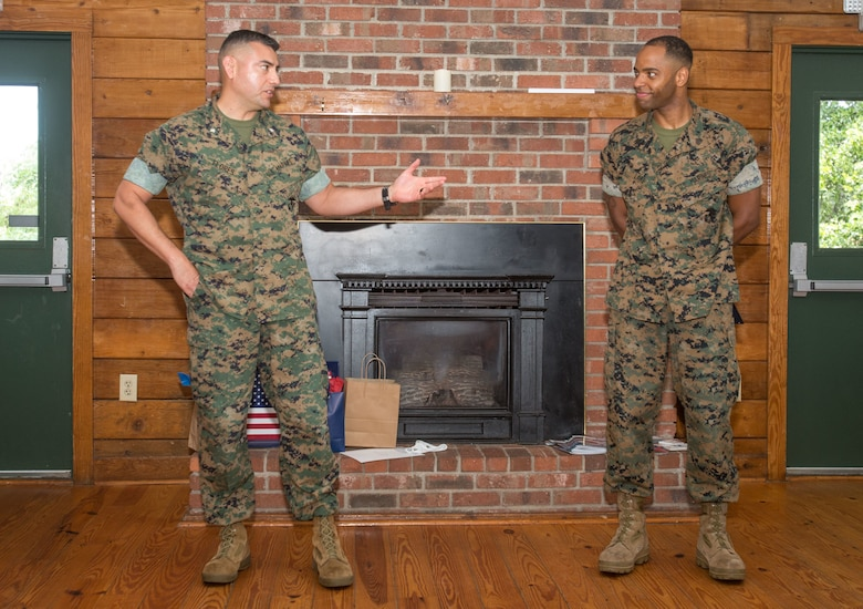 U.S. Marine Corps Lt. Col. Julian Flores, left, commanding officer of Headquarters and Headquarters Squadron (H&HS), congratulates Sgt. Donatien Lake III, right, an aviation operation specialist with H&HS, for receiving the Service Person of the Quarter award at the Hancock Lodge, Marine Corps Air Station Cherry Point, North Carolina, July 28, 2020