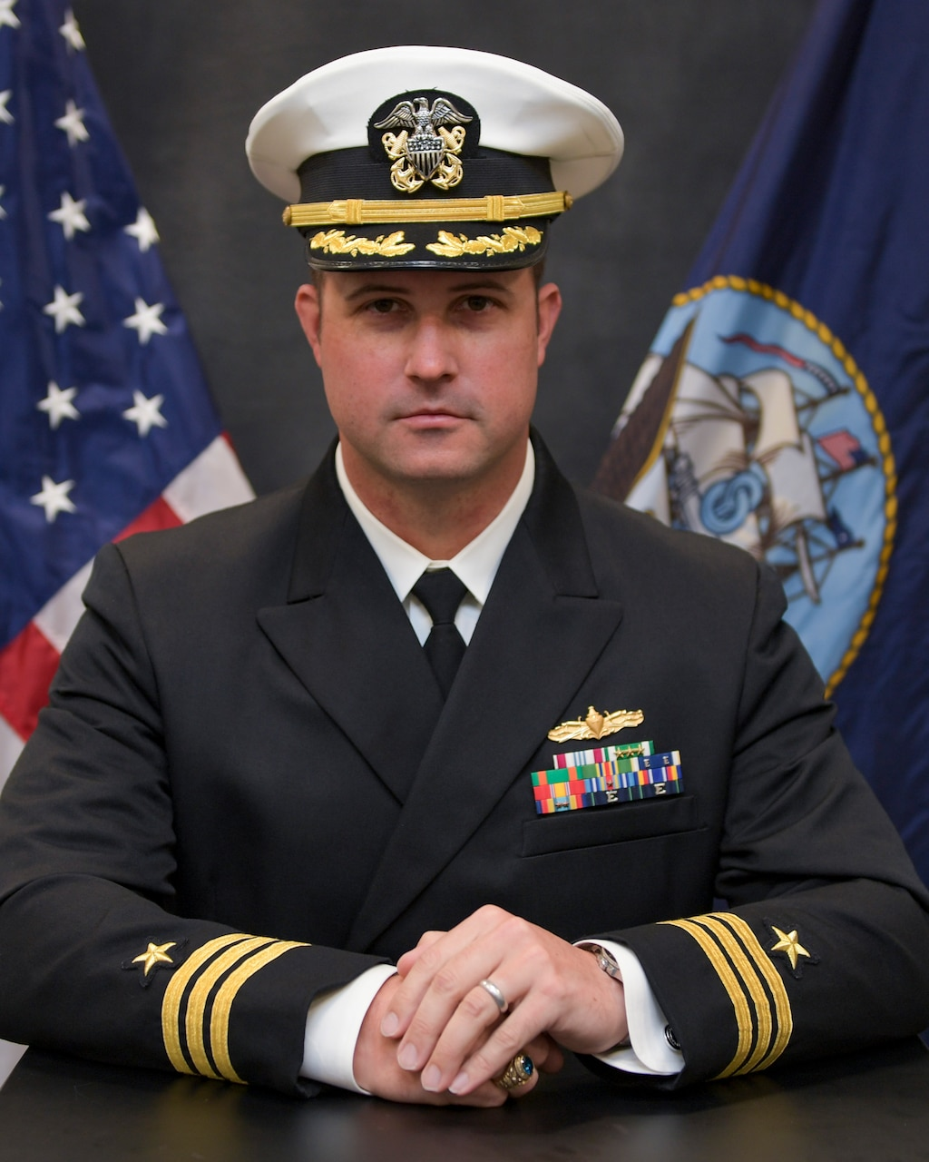 Cmdr. Jim Welsch, executive officer of the Arleigh Burke-class guided-missile destroyer USS Cole (DDG 67), poses for a studio portrait.