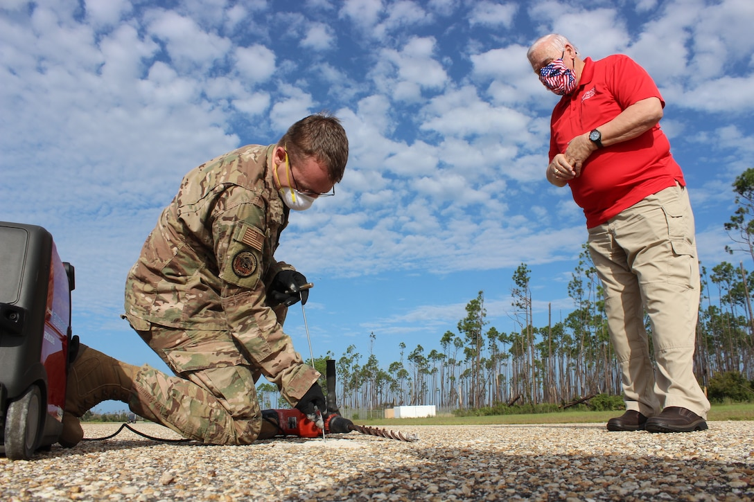 Contingency Airfield Pavement Evaluation course training instructor, Dick Smith, provides instruction on how to gather data to assess airfield pavement.