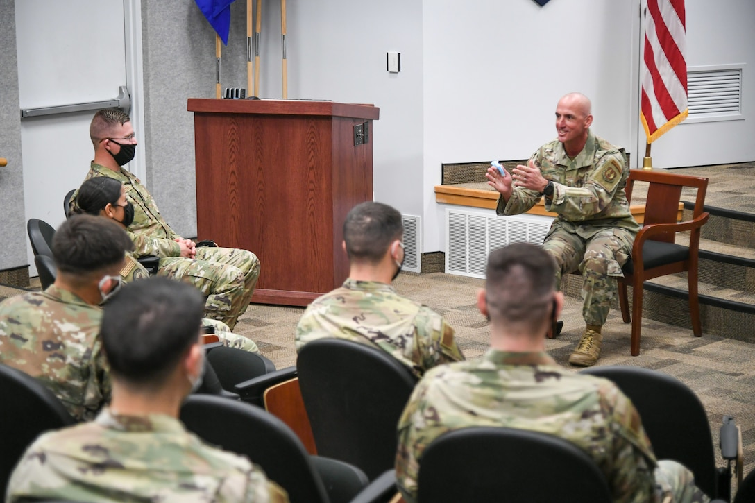 Chief Master Sgt. David Flosi, Air Force Sustainment Center commander chief master sergeant, visits with Airmen