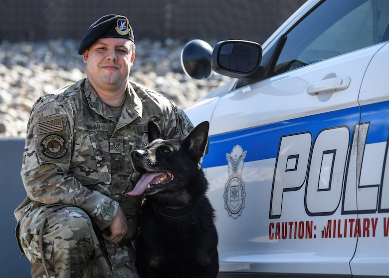 military working dog handler poses for photo