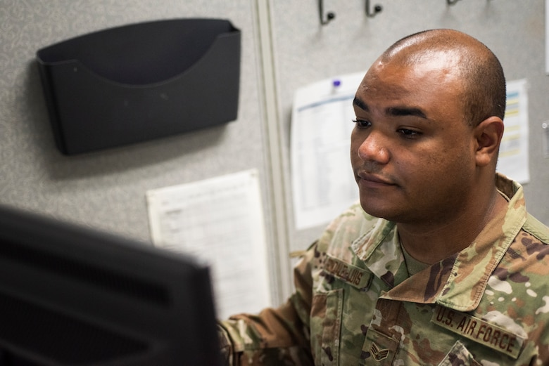 Senior Airman Kevin Gonzalez-Luis, installation personnel readiness Airman, 108th Force Support Squadron, works at his computer in the 108th FSS building on Joint Base McGuire-Dix-Lakehurst, N.J., Sept. 13, 2020. (U.S. Air National Guard photo by Staff Sgt. Ross A. Whitley)