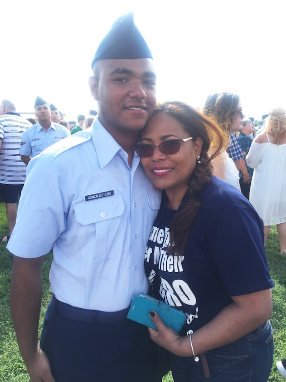 Senior Airman Kevin Gonzalez-Luis, installation personnel readiness Airman, 108th Force Support Squadron, hugs his mom after his basic military training graduation at Joint Base San Antonio, Texas, June 17, 2016. (Courtesy Photo)