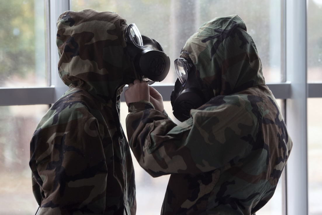 Two chemical, biological, radiological, and nuclear defense course students perform buddy checks, Ramstein Air Base, Germany, Sept. 24, 2020.
