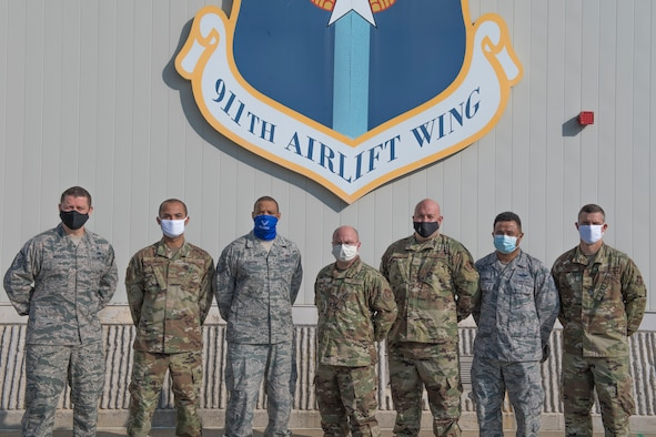 Members of the 911th Airlift Wing Recruiting Flight pose for a group photo at the Pittsburgh International Airport Air Reserve Station, Pennsylvania, Sept. 28, 2020.