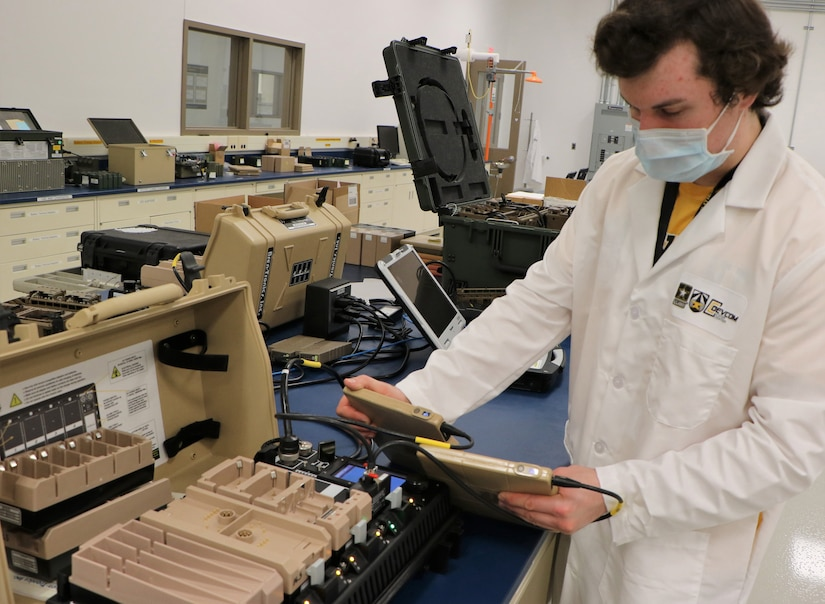 A researcher in a lab conducts a test on a wearable battery prototype.