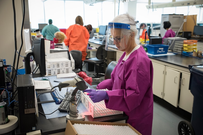 Delinda Rillo, a medical specimen processing assistant from the United States Air Force School of Aerospace Medicine's Epidemiology Laboratory logs in samples for COVID-19 testing June 2, 2020. The Epi Lab is the sole clinical reference lab in the Air Force, and USAFSAM is part of AFRL's 711th Human Performance Wing headquartered at Wright-Patterson Air Force Base in Dayton, Ohio. (U.S. Air Force photo by Richard Eldridge)