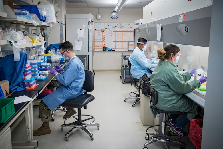 Medical laboratory technicians (left) Staff Sgt.Taylor Wiens and (front right) Dannielle Parlett with Tech. Sgt. Kevin Blevins (back right), NCOIC, Microbiology, from the United States Air Force School of Aerospace Medicine's Epidemiology Laboratory are separating a larger sample into smaller parts for COVID-19 testing. The Epi Lab is the sole clinical reference lab in the Air Force, and USAFSAM is part of AFRL's 711th Human Performance Wing headquartered at Wright-Patterson Air Force Base in Dayton, Ohio.  (U.S. Air Force photo by Richard Eldridge)