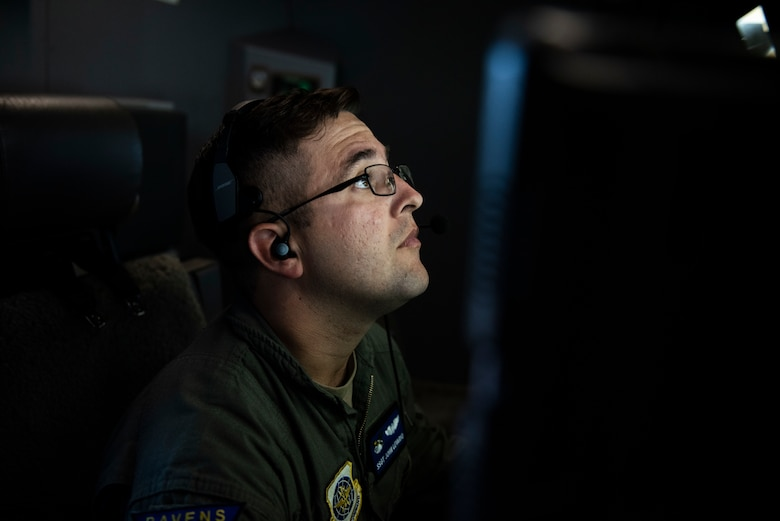 Staff Sgt. John Levano, 344th Air Refueling Squadron, prepares the KC-46 Pegasus to refuel a C-17 Globemaster III during a demo flight for Gen. Ken Wilsbach, Pacific Air Forces commander, Joint Base Pearl Harbor-Hickam, Hawaii, Sept. 22, 2020. The flight served as an opportunity for Wilsbach to become familiar with the KC-46 as well as learn about the Advanced Battle Management System being tested aboard the aircraft. (U.S. Air Force photo by Staff Sgt. Hailey Haux)