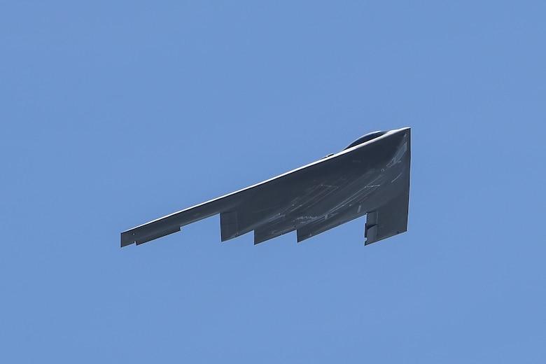 A B-2 Spirit stealth bomber flies through the skies above Plant 42 in Palmdale, California, April 12, 2019. The Air Force's B-2 fleet undergoes undergo programmed depot maintenance every nine years at the Northrop Grumman facility at Plant 42. (Photo courtesy of Alan Radecki/Northrop Grumman)