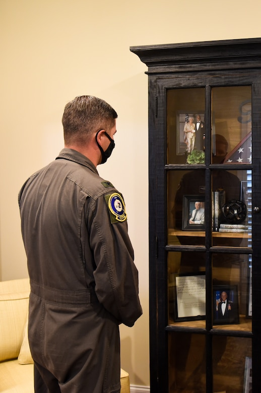 "Col. David Fazenbaker, 14th Flying Training Wing vice commander, looks at the memorabilia of Ret. Col. Carlyle ""Smitty"" Harris, former Vietnam prisoner of war, on September 18, 2020, in Tupelo, Miss. Harris wrote a book called ""Tap Code"", which he wrote about his experiences and hardships as a POW. (U.S. Air Force photo by Airman 1st Class Davis Donaldson)"
