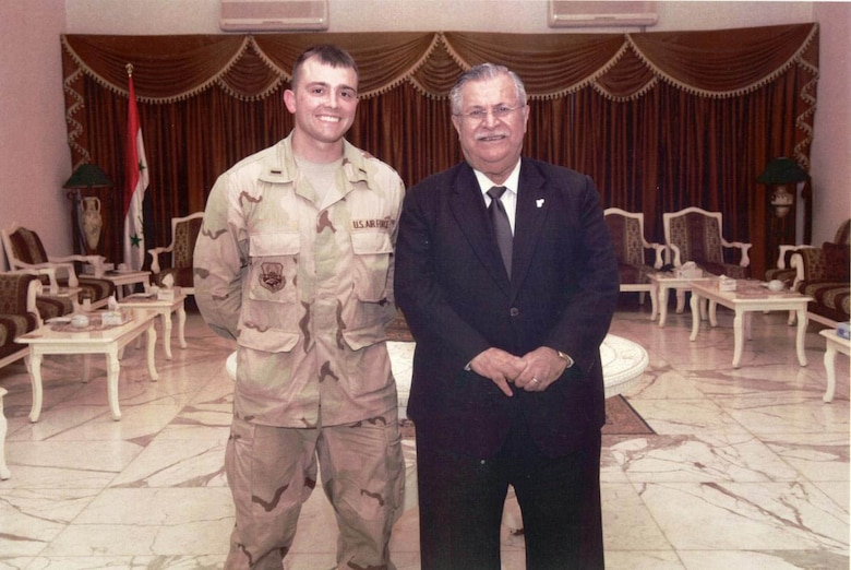 A young Lt. Col. Robert, now-15th Attack Squadron commander, stands alongside then-President of Iraq, President Talibani in Baghdad, Iraq, May 2007.
