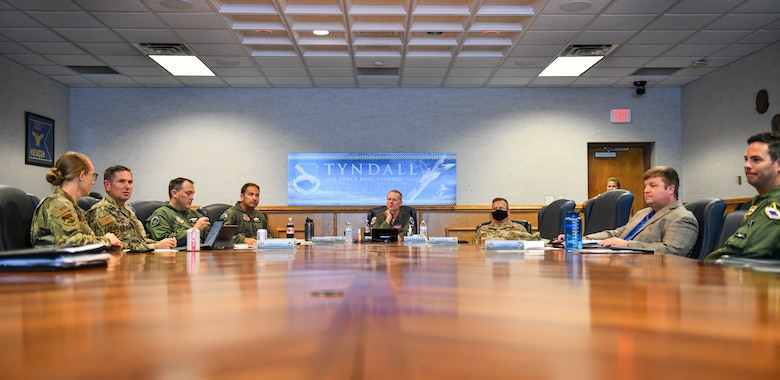 U.S. Air Force Gen. Mark Kelly (center), commander of Air Combat Command, and 325th Fighter Wing leadership converse before a briefing at Tyndall Air Force Base, Florida, Sept. 28, 2020. Kelly was briefed on Tyndall's master plan for the rebuild before going on a tour of the base to see some of the facilities that have been renovated. (U.S. Air Force photo by Senior Airman Stefan Alvarez)