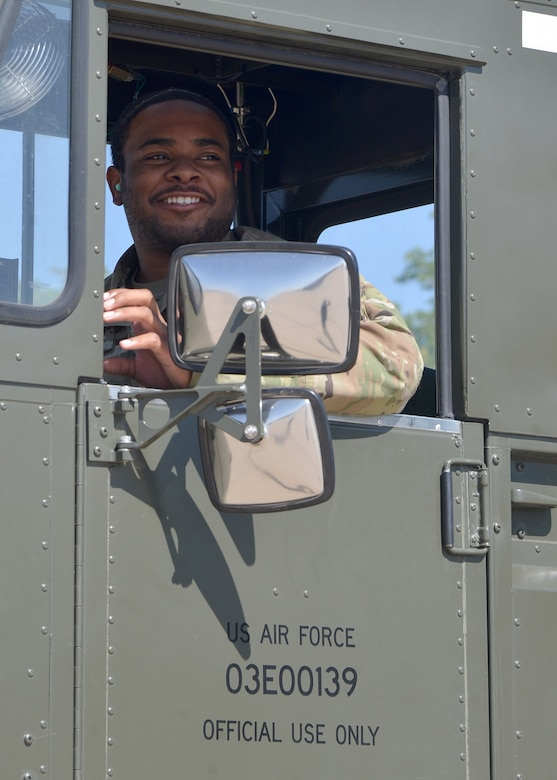 Man operates cargo loading vehicle