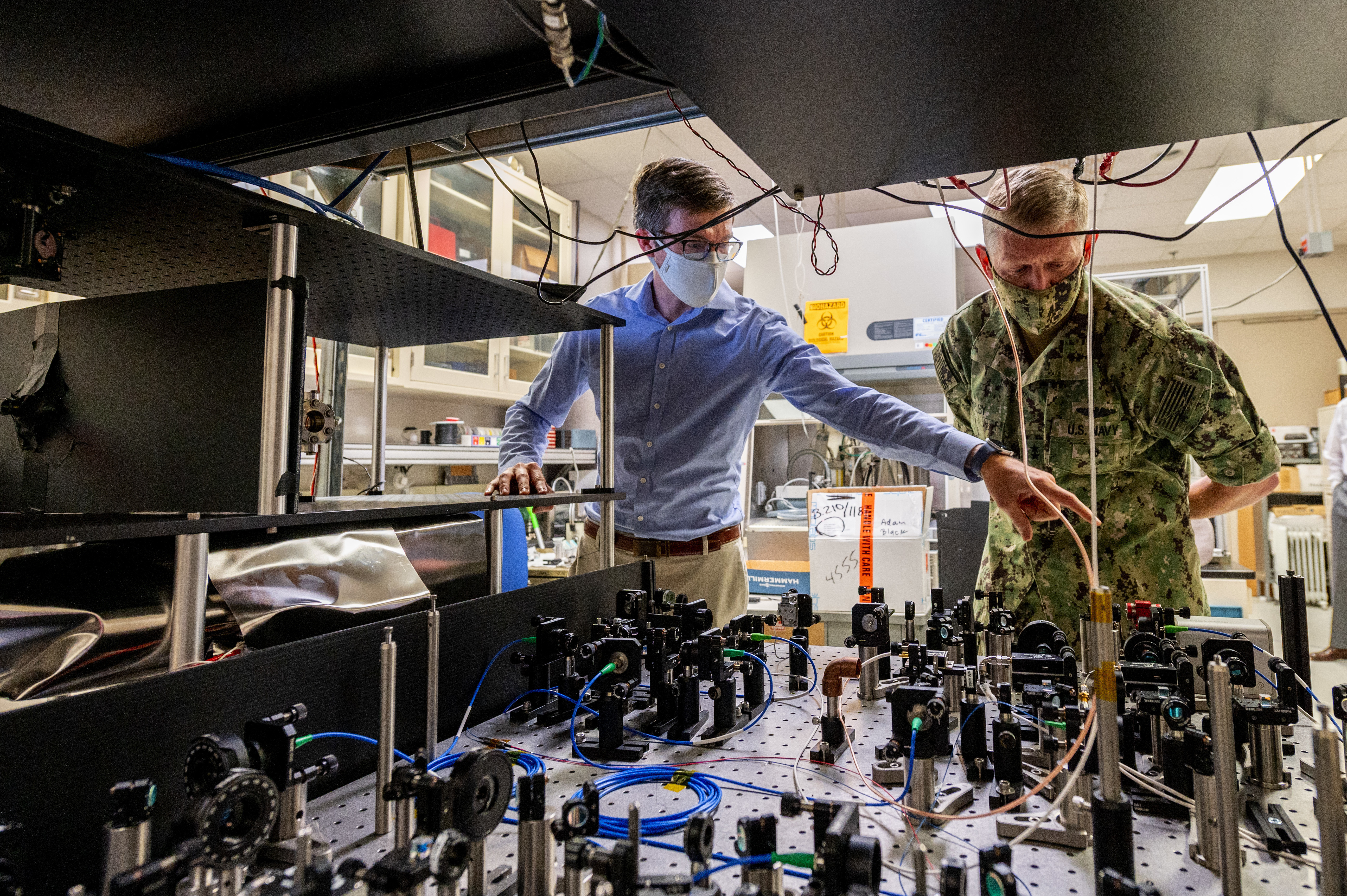 Jonathan Kwolek, a U.S. Naval Research Laboratory research physicist, shows an atom interferometer to Chief of Naval Research Rear Adm. Lorin Selby Sept. 14, 2020, at Naval Research Labratory (NRL) facilities in Washington, D.C.