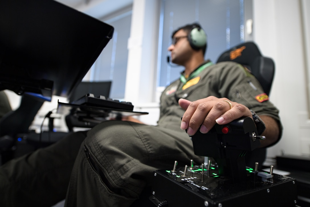 Photo of Airmen using a flying simulator