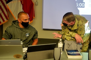 North Carolina Army National Guard Robbie Felicio, North Carolina National Guard (NCNG) Chief Information Officer, left, and NCNG Adjutant General Maj. Gen. Maj. Gen. Todd Hunt discuss cyber operations during Cyber Shield 2020 held at the NCNG's Fort Fisher Training Center, Kure Beach, North Carolina, Sept. 24, 2020.  Cyber Shield 2020 is a virtual national exercise where NCNG participants join their National Guard peers across the country, testing their response to real world cyber threats to government and private industry networks and information technology infrastructure. (U.S. Army National Guard photo by Robert Jordan, North Carolina National Guard Public Affairs)