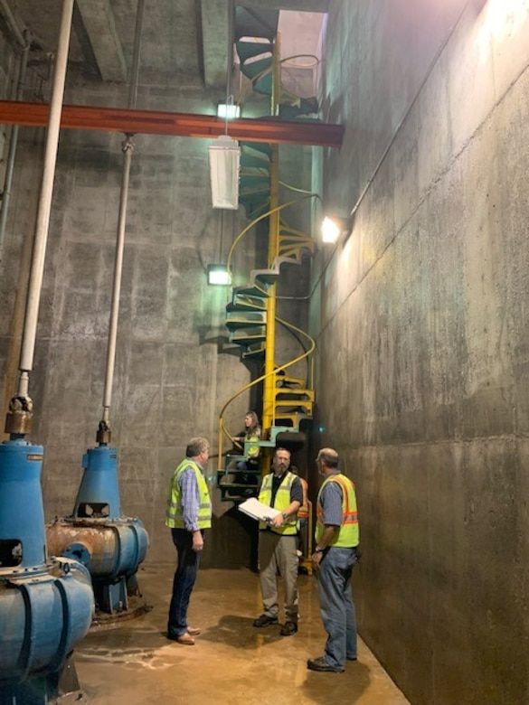 Workers discuss coming improvements inside the 5th Street Pump Station in Kansas City, Kansas September 29, 2020.