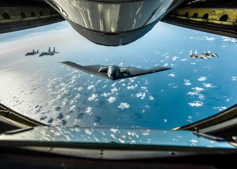 A B-2 Spirit Stealth Bomber, assigned to the 509th Bomb Wing at Whiteman Air Force Base, Missouri, two Royal Air Force F-35 Lightning IIs assigned to RAF Marham, England, and two F-15 Eagles assigned to the 48th Fighter Wing at RAF Lakenheath, England, fly in formation behind a KC-135 Stratotanker, assigned to RAF Mildenhall, England, during a training mission for Bomber Task Force Europe on September 16, 2019. Three B-2 bombers, Airmen and support equipment from Whiteman AFB deployed to RAF Fairford, England, as part of Bomber Task Force Europe. These multinational missions enhance our professional relationships and improves overall coordination with allies and partner militaries during times of crisis. (U.S. Air Force photo by Senior Airman Thomas Barley)