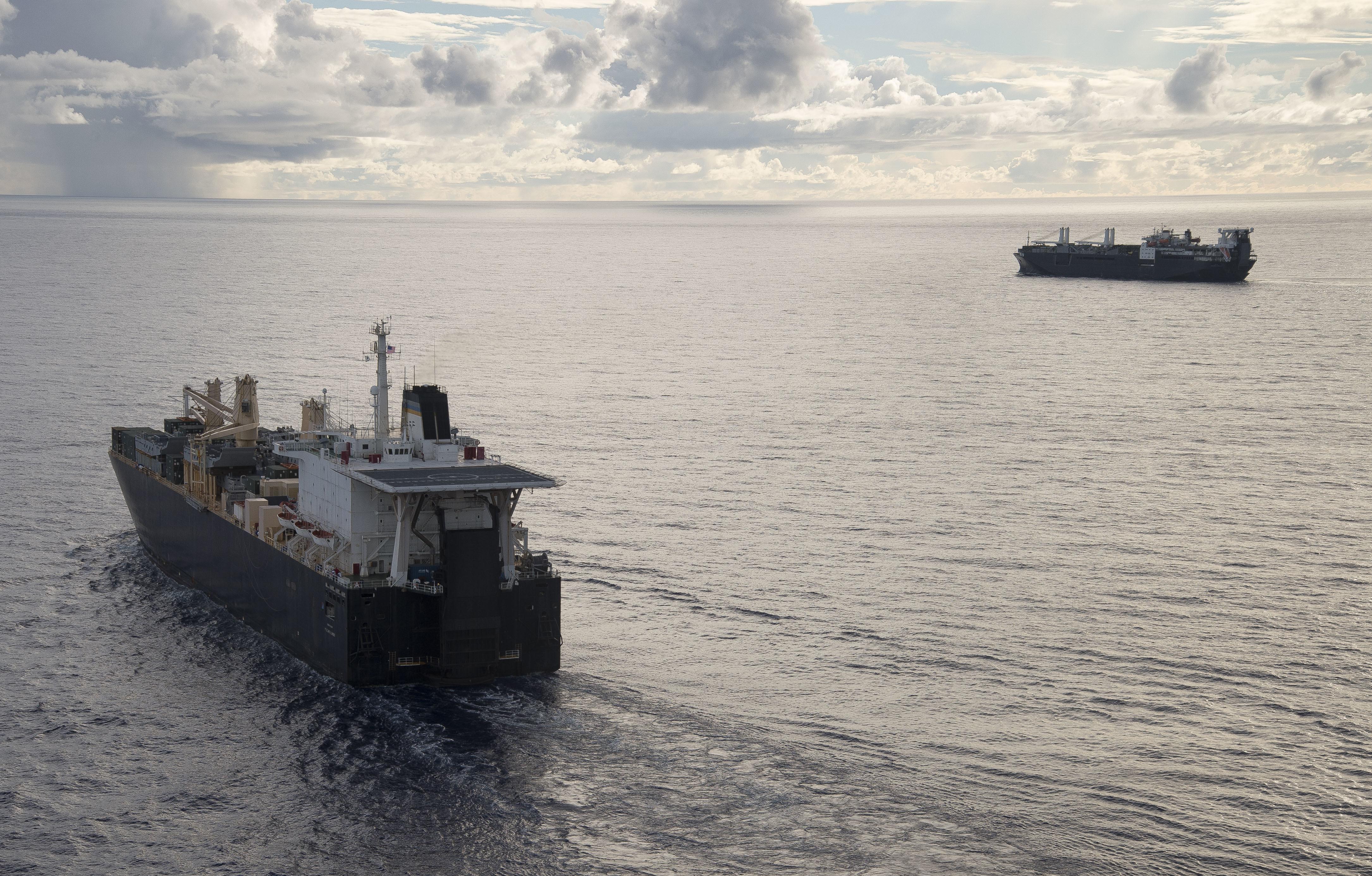 USNS 1st LT Jack Lummus (T-AK 3011) executes a Group Sail with Maritime Prepositioning Ships Squadron (MPSRON 3) off the coast of Guam, Oct. 4, 2017.