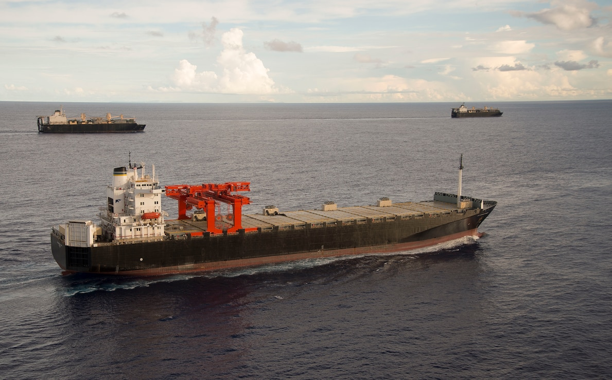 USNS MV Maj. Bernard F. Fisher (T-AK 4396) executes a Group Sail with Maritime Prepositioning Ships Squadron (MPSRON 3) off the coast of Guam, Oct. 4, 2017.