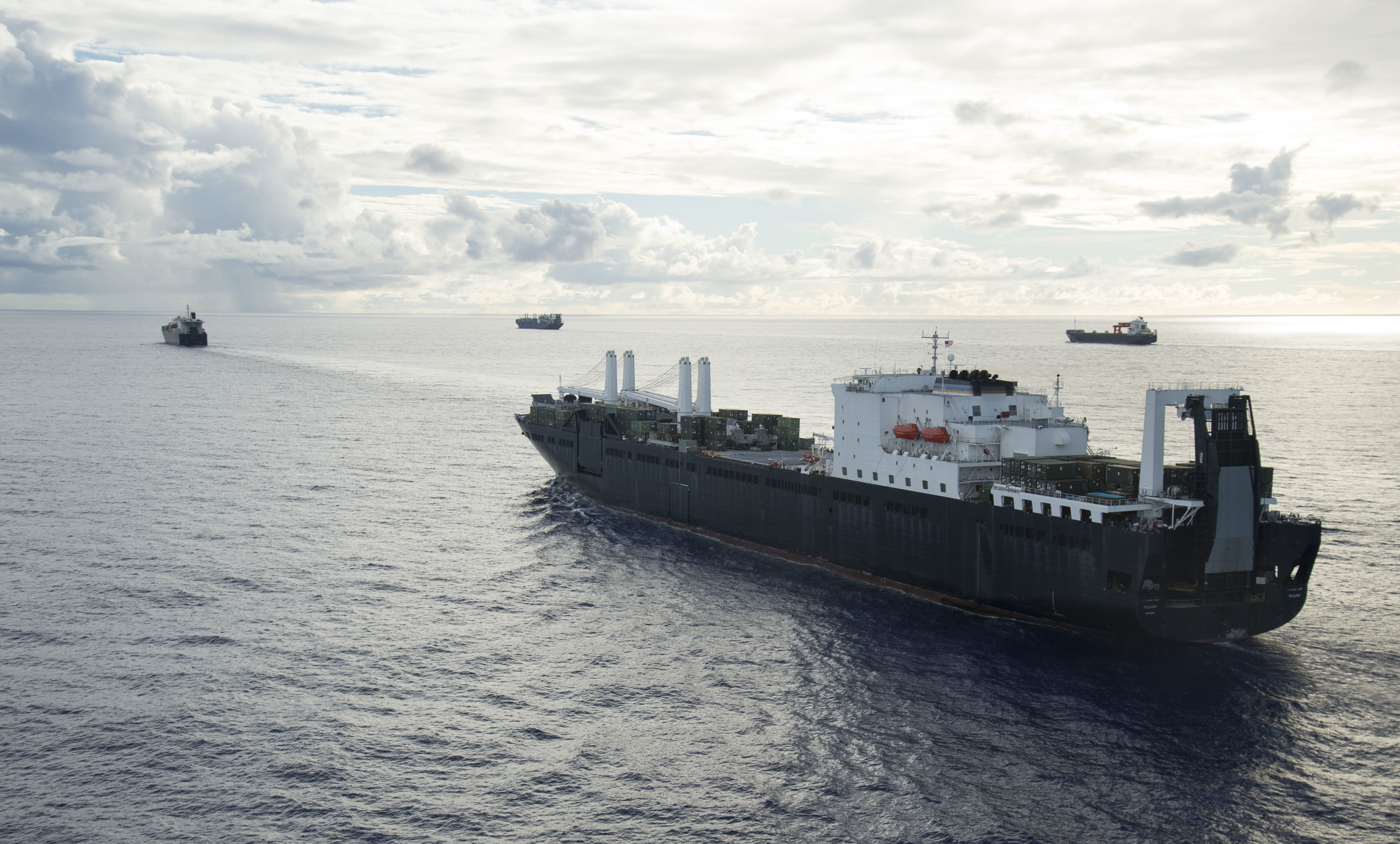 USNS Pililaau (T-AK 304) executes a Group Sail with Maritime Prepositioning Ships Squadron (MPSRON 3) off the coast of Guam, Oct. 4, 2017.